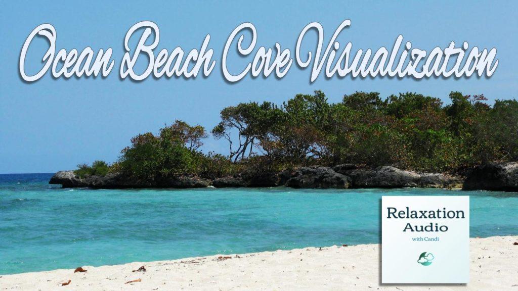 tropical white beach beside trees and rocks